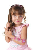 Little girl combs her hair — Stock Photo