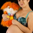 Beautiful pregnant woman with a toy — Stock Photo #7210330