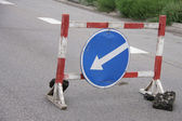 Temporary warning road sign with arrow — Stock Photo
