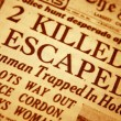 Daily newspaper headline that reads killed and escaped — Stock Photo