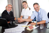 Mature architect shaking hands with a client — Stock Photo