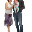 Portrait of a happy young family standing — Stock Photo