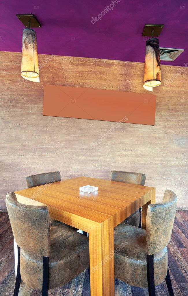 Wooden table and leather chairs in a restaurant.  — Stock Photo #7526657
