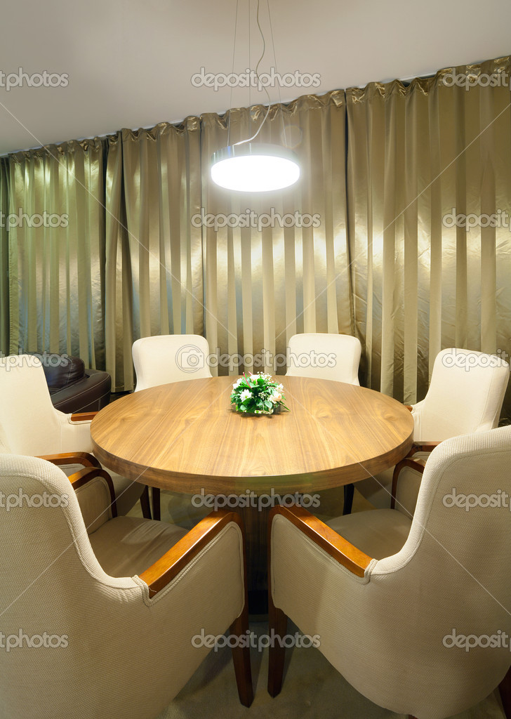 A part of a hotel interior, table and armchairs all around. — Stock Photo #7586738
