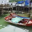 Tai O fishing village with stilt house and old boat — Stock Photo #6880947