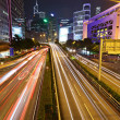 Stock Photo: Fast moving cars at night
