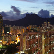 Crowded building at night in hong kong — Stock Photo