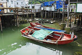 Tai O fishing village with stilt house and old boat — Stock Photo