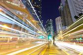 Traffic through the city at night — Stock Photo