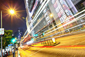 Modern urban city at night with traffic — Stock Photo