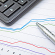 Financial charts on the table — Stock Photo