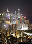 Hong Kong with crowded buildings at night — Foto Stock
