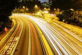 Light trails in mega city — Stock Photo