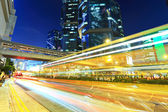 Car light trails in modern city — Stock Photo