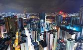 Hong kong con edificio affollato di notte — Foto Stock