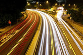 Car trails in city — Stock Photo