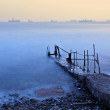 Old pier at sunset — Stock Photo