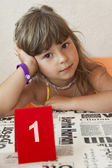 The child behind the first table — Stock Photo
