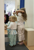 Children in a fitting room — Stock Photo