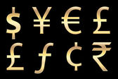 Currencies symbols in gold — Stock Photo