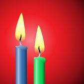 Twee kaarsen — Stockvector