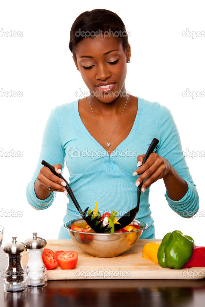 Beautiful health conscious young woman tossing healthy organic salad in kitchen, isolated. — Stock fotografie #6839085