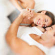 Royalty-Free Stock Photo: Young couple enjoying themselves on bed