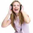 Excited young female listening to music on headphones - Zdjęcie stockowe