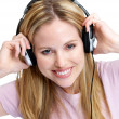 Beautiful young lady listening to music on headphones - Zdjęcie stockowe