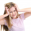Royalty-Free Stock Photo: Frustration - Blond young girl holding her head