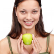 Royalty-Free Stock Photo: Cute young girl holding a green apple