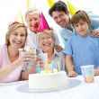 Happy family celebrating birthday together - Stock Photo