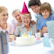 Royalty-Free Stock Photo: Pretty mature female celebrating with family