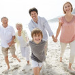 Happy family walking on the beach - Outdoor - Stock Photo