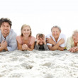 Cute family lying down on the beach - Outdoor - Stock Photo
