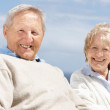 Cute senior couple sitting together - Outdoor - Stock Photo