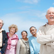 Royalty-Free Stock Photo: Handsome senior man standing with his friends in background