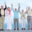 Royalty-Free Stock Photo: Group of mature friends with hand raised against the sky