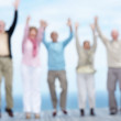 Royalty-Free Stock Photo: Group of old friends jumping with hand raised - Outdoor