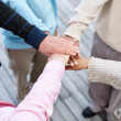 Unity - Group of old hands on top of each other - Foto de Stock  