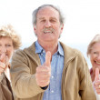 Royalty-Free Stock Photo: Group of happy old friends showing thumbs up sign