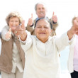 Royalty-Free Stock Photo: Lovely old woman showing thumbs up sign with friends