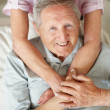 Royalty-Free Stock Photo: Handsome old man smiling with his wife - Top view