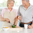 Royalty-Free Stock Photo: Old couple enjoying themselves in the kitchen