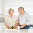 Royalty-Free Stock Photo: Smiling senior couple standing together in the kitchen