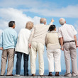 Royalty-Free Stock Photo: Group of senior friends looking at sky - Outdoor