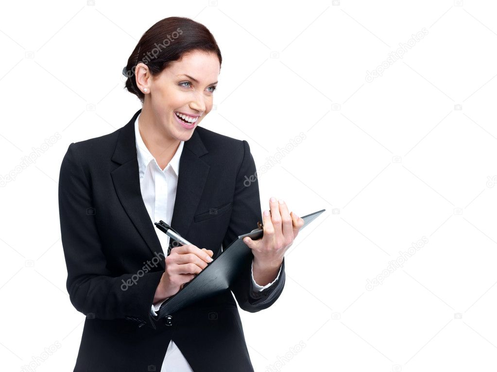 Portrait of a happy young business woman looking at something interesting while taking notes — Stock Photo #7703124