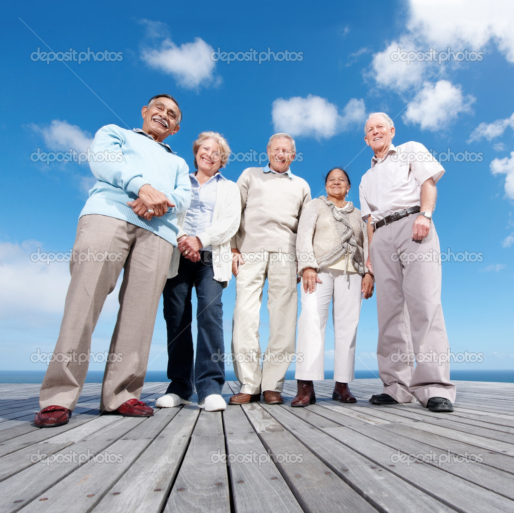 ... of mature friends standing on the wooden plank against the sky - Outdoor