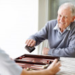 Royalty-Free Stock Photo: Elderly person playing backgammon with a young guy