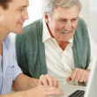 Royalty-Free Stock Photo: Old father and son working on laptop